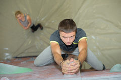 Downward view man gripping climbing wall Royalty Free Stock Image