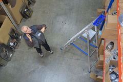 Downward view man in storeroom. Downward view of man in storeroom stock photography