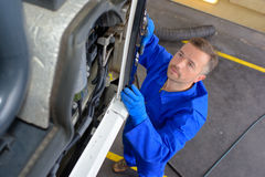 Downward view mechanic at work. Downward view of mechanic at work royalty free stock images