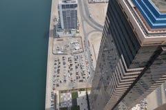 Downward view to skyscraper in close neighbourship. Downward view from skyscraper down from 58th Level, in Dubai, UAE stock photo
