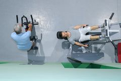 Downward view two men on exercise machines. Downward view of two men on exercise machines stock photo