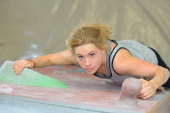 Downward view woman climbing. Downward view of woman climbing royalty free stock photography