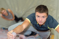 Downward view young man on climbing wall. Downward view of young men on climbing wall royalty free stock image