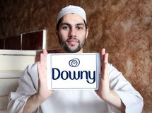 Downy brand logo. Logo of Downy brand on samsung tablet holded by arab muslim man. Downy is a brand name of fabric softener produced by Procter & Gamble and sold Stock Photos
