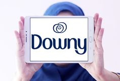 Downy brand logo. Logo of Downy brand on samsung tablet holded by arab muslim woman. Downy is a brand name of fabric softener produced by Procter & Gamble and Royalty Free Stock Image