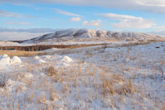 Downy snow on the hills of Bannoye lake Royalty Free Stock Photography