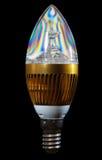 DOWODZONA energooszczędna żarówka na czarnym tle Fotografia Stock