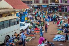 Dowtown market scene. Jinja, Uganda - September 2015 - A downtown fruits market scene. The vendors, who are mostly subsistence farmers, grow the fruits for home Royalty Free Stock Images
