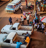 Dowtown scene. Jinja, Uganda -September 2015 - A view of downtown park side, Jinja. This is the part of town where vehicles for hire cheaply are found Stock Images