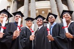 Doyen multiculturel de diplômés photo stock