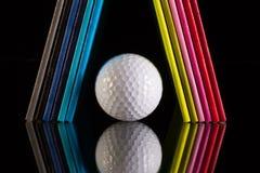 Doze diários e bolas de golfe diferentes das cores Imagem de Stock