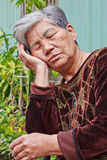 Doze old woman. A White hair Doze Chinese old woman on Chair Outdoor royalty free stock images