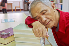 Doze reader. A Doze reader who is reading in the library stock photo