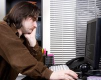 Dozed off in office. The man dozed off at the computer monitor in the office Stock Photography