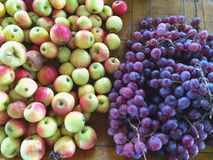 Dozen of Apple and bunch of grapes on the table Stock Photo