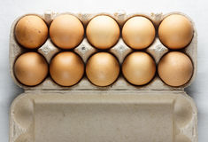 A dozen brown eggs top shooting Stock Images