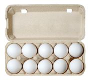 A dozen chicken eggs in a carton. royalty free stock images