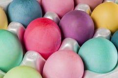 Dozen colored Easter eggs,carton Royalty Free Stock Photos