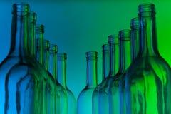 Dozen crystal bottlenecks of empty wine bottles Royalty Free Stock Images