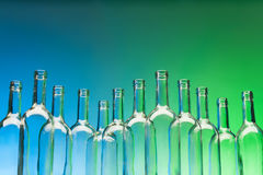 Dozen crystal wine bottles standing in line stock photography