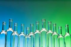 Dozen crystal wine bottles standing in line Stock Photography