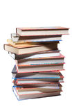 Dozen different books, stacked Stock Photo