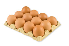 A dozen eggs. A box of fresh hens eggs isolated on white with clipping path Royalty Free Stock Image