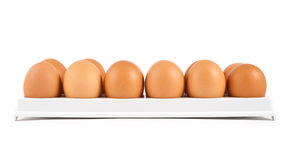 Dozen of eggs in a case isolated Royalty Free Stock Image