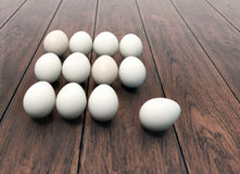 Dozen of eggs on wooden background Stock Photography