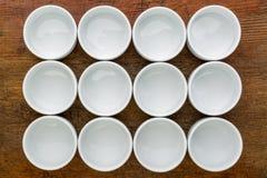 Dozen of empty white tasting bowls Stock Photography