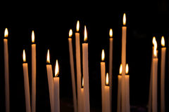 Dozen of lighten large candles Stock Photography
