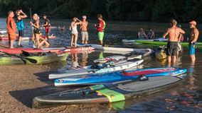 A dozen paddle boards and a kayak stock images