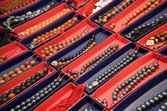 Dozen van ambergebedparels Stock Foto's