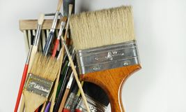 A dozen of various paintbrushes, used and new. Different sizes a royalty free stock images
