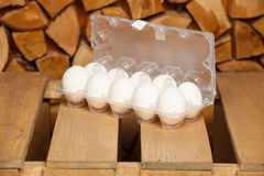 Dozen of white eggs Stock Images
