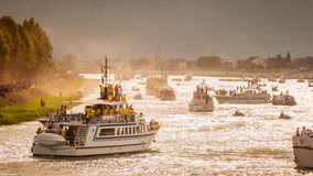 Dozens of boats on the river Neretva with several thousand spectators watch the traditional boat marathon in Metkovic, Croatia Royalty Free Stock Photos