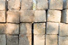Dozens of concrete pillars on the grass during sunny day. Novi Sad, Serbia royalty free stock images