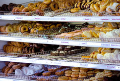 Dozens of donuts for sale Royalty Free Stock Images
