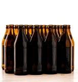 Dozens of empty, brown German beer bottles Royalty Free Stock Photos