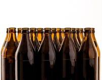 Dozens of empty, brown German beer bottles Stock Images