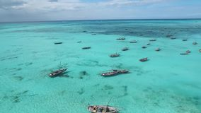 Fishermen boats sailing in turquoise waters, aerial , panorama. Dozens of fishermen boats sailing in the ocean, calm turquoise waters, aerial shot, panorama stock video
