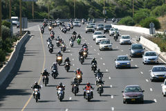Dozens of motorcycle riders. Riding on highway Royalty Free Stock Photos