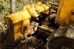 Dozer Blade Against Tree. Track crawler bull dozer blade stock image