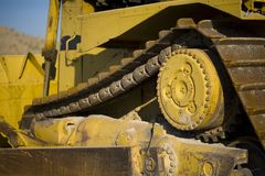 Dozer details. Close up of a yellow construction dozer Royalty Free Stock Photos