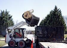 Dozer Dumping large Logs Royalty Free Stock Image