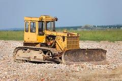 Dozer. Old dozer at a construction site stock image