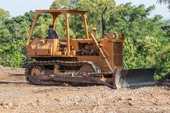 Dozer. Old dozer at a construction site royalty free stock photos