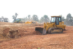 Dozer shaping land Royalty Free Stock Photo