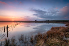 Dozmary Pool on Bodmin Moor. Beautiful sunset over Dozmary Pool the only natural lake on Bodmin Moor in Cornwall and steeped in Arthurian legend Royalty Free Stock Photo