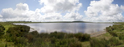Dozmary Pool, Bodmin Moor, Cornwall. Dozmary Pool on a summers day. Bodmin Moor, Cornwall, England Royalty Free Stock Photography